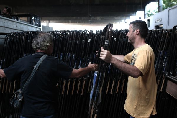 Municipal workers store booths in a warehouse in Athens, Greece, on July 2, 2015, in preparation for the upcoming referendum.