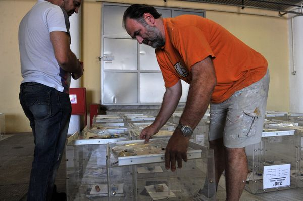 Electoral workers prepare ballot boxes in a warehouse in Thessaloniki, Greece, on July 2, 2015, ahead of the upcoming referen