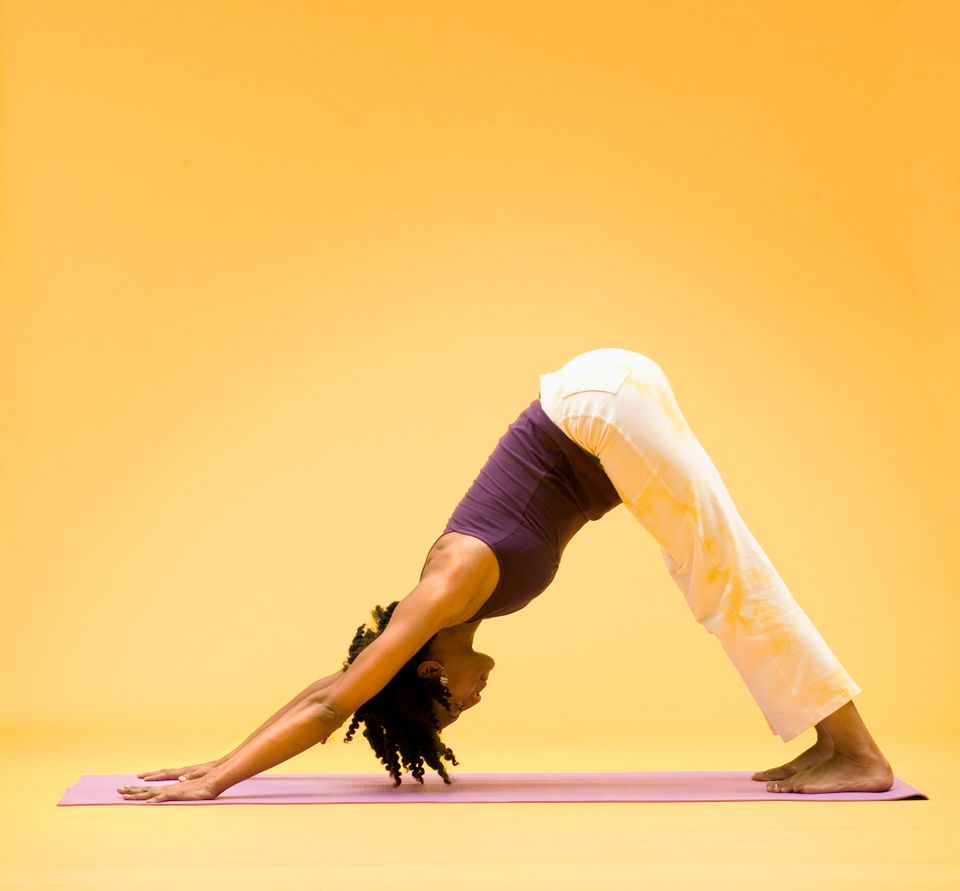 If you only do one yoga pose after a long day at work, make it a downward-facing dog, a holistic pose that stretches and stre