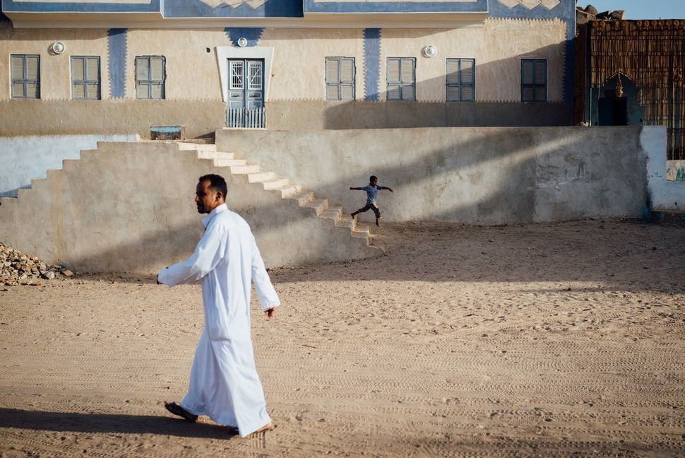 Mourad walks on Seheil Island. Many of the Nubian families who refused to immigrate to the land offered to them by the govern
