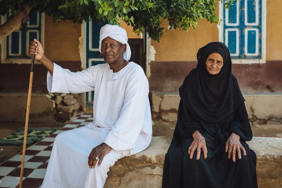 Hajj Elias and his wife Fayza in front of their house in the immigration area near Kom Umbo. These houses were offered by the