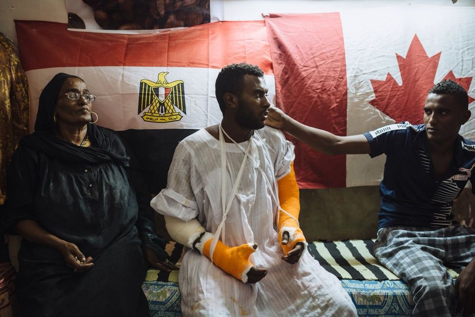 Mohamed broke both his arms while playing football. People from Seheil Island were collecting money for the operation as his
