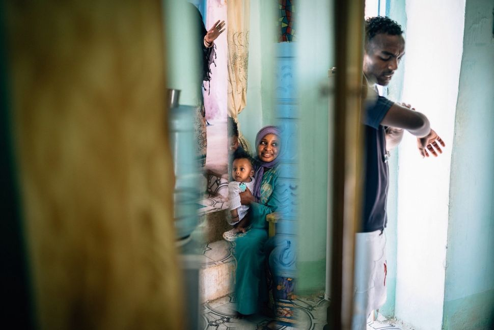 Sabrine and her 6-month-old son Mohammed in their home on Heisa Island. Most men work in Aswan during the day, leaving the wo