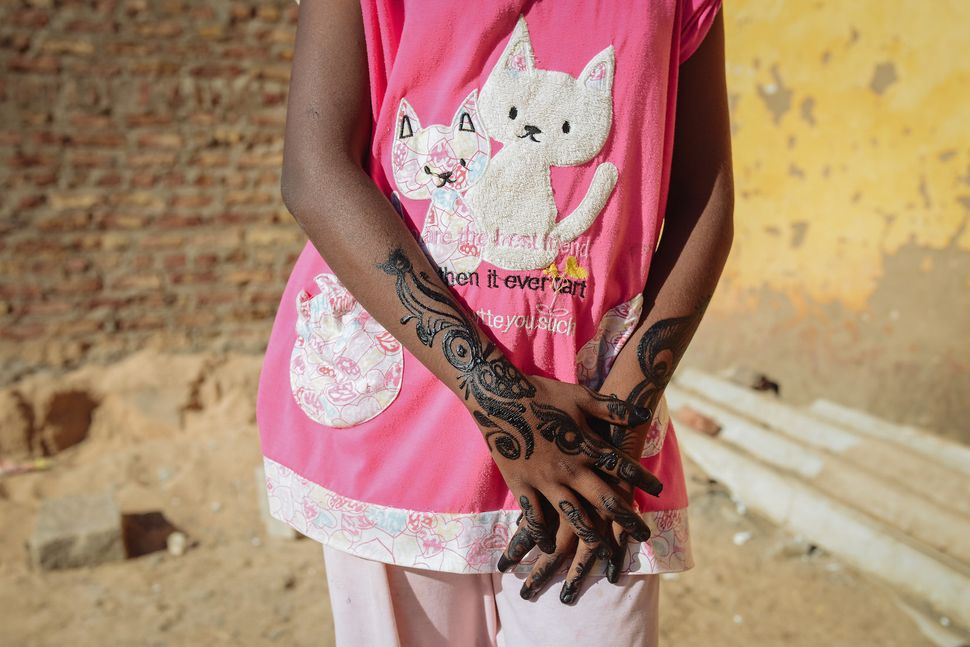 A girl is waiting for her finished henna to dry. Henna has been grown and used in Southern Egypt, and particularly in Nubia,