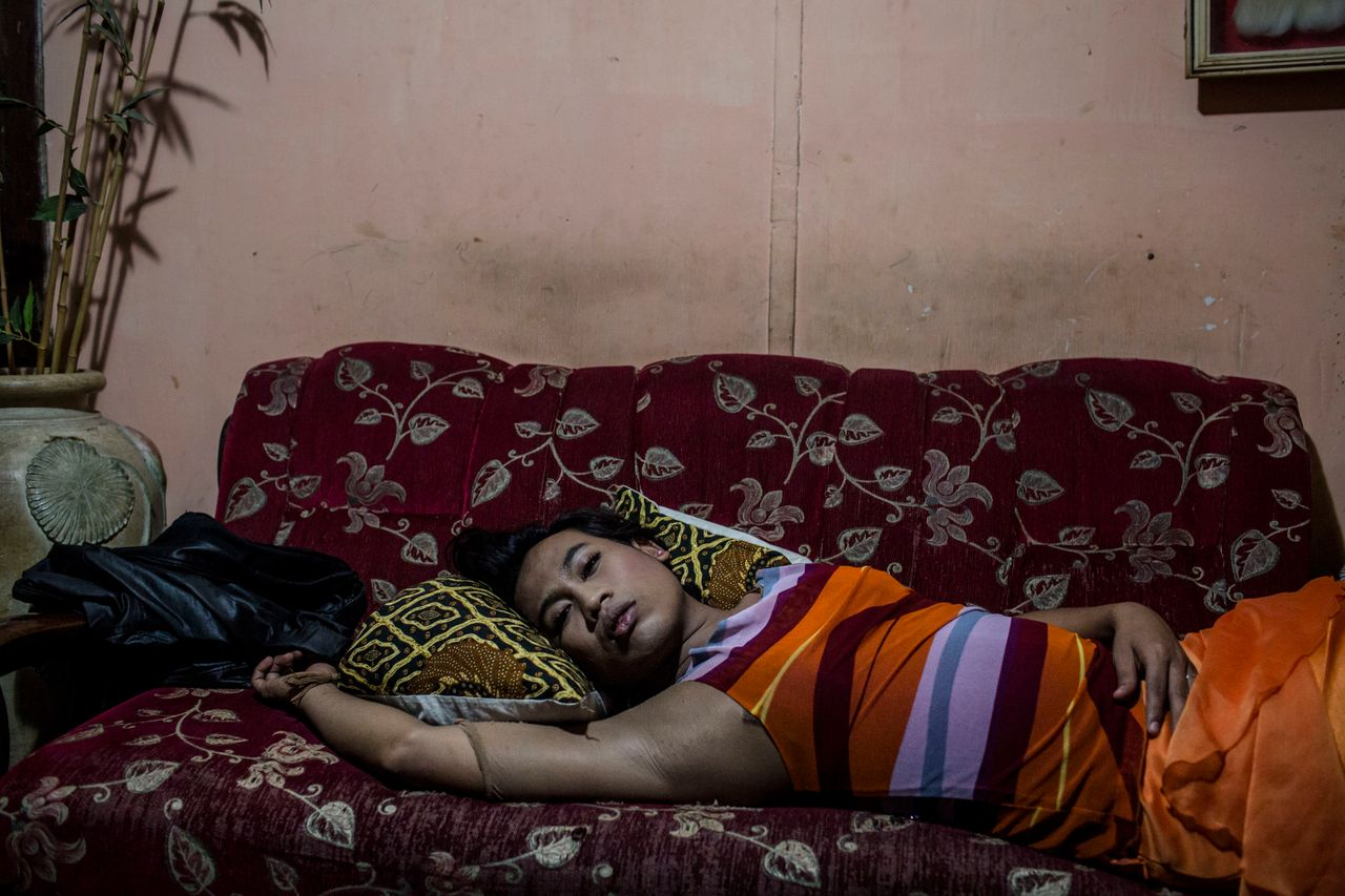 YOGYAKARTA, INDONESIA - JULY 12: Inez, a member of a Pesantren boarding school, Al-Fatah, for transgender people known as 'waria' take a rest as waiting for break the fast during Ramadan on July 12, 2015 in Yogyakarta, Indonesia. During the holy month of Ramadan the 'waria' community gather to break the fast and pray together. 'Waria' is a term derived from the words 'wanita' (woman) and 'pria' (man). The Koran school Al-Fatah was set back last year's by Shinta Ratri at her house as a place for waria to pray, after their first founder Maryani died. The school operates every Sunday. Islam strictly segregates men from women when praying, leaving no-where for 'the third sex' waria to pray before now. (Photo by Ulet Ifansasti/Getty Images)