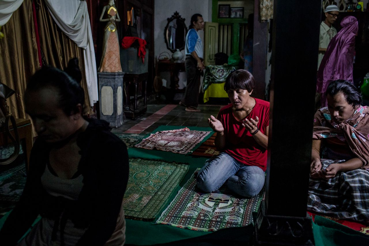 YOGYAKARTA, INDONESIA - JULY 12: Members of a Pesantren boarding school, Al-Fatah, for transgender people known as 'waria' pray during Ramadan on July 12, 2015 in Yogyakarta, Indonesia. During the holy month of Ramadan the 'waria' community gather to break the fast and pray together. 'Waria' is a term derived from the words 'wanita' (woman) and 'pria' (man). The Koran school Al-Fatah was set back last year's by Shinta Ratri at her house as a place for waria to pray, after their first founder Maryani died. The school operates every Sunday. Islam strictly segregates men from women when praying, leaving no-where for 'the third sex' waria to pray before now. (Photo by Ulet Ifansasti/Getty Images)