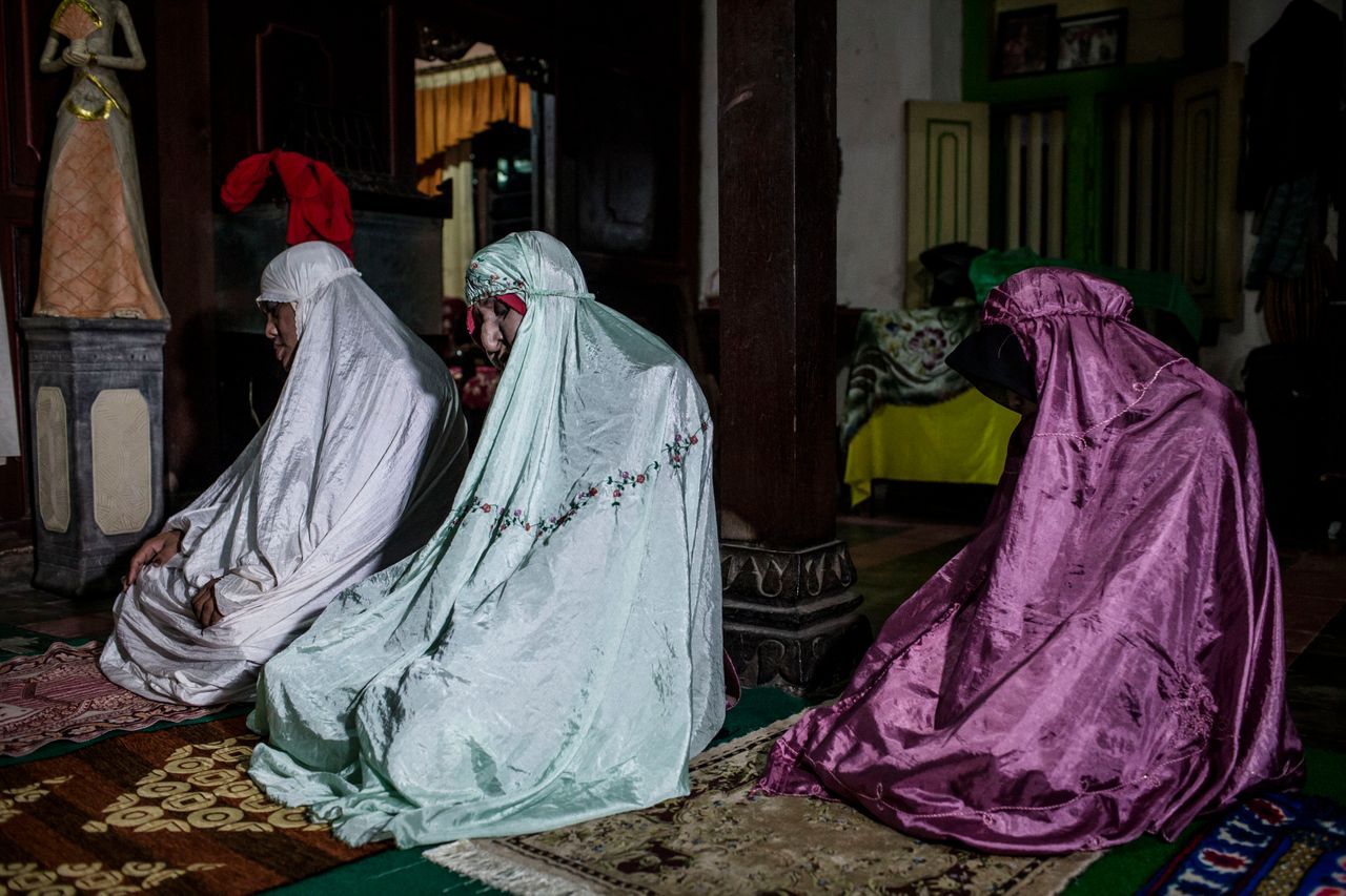 YOGYAKARTA, INDONESIA - JULY 12: Members of boarding school for transgenders known as pesatren 'waria', called Al-Fatah, praying during observe ramadan on July 12, 2015 in Yogyakarta, Indonesia. During the holy month of Ramadan the 'waria' community do activities gather to break the fast and pray together. 'Waria' is a term derived from the words 'wanita' (woman) and 'pria' (man). The Koran school Al-Fatah was set back last year's by Shinta Ratri at her house as a place for waria to pray, after their first founder Maryani died. The school operates every sunday. Islam strictly segregates men from women when praying, leaving no-where for 'the third sex' waria to pray before now. (Photo by Ulet Ifansasti/Getty Images)