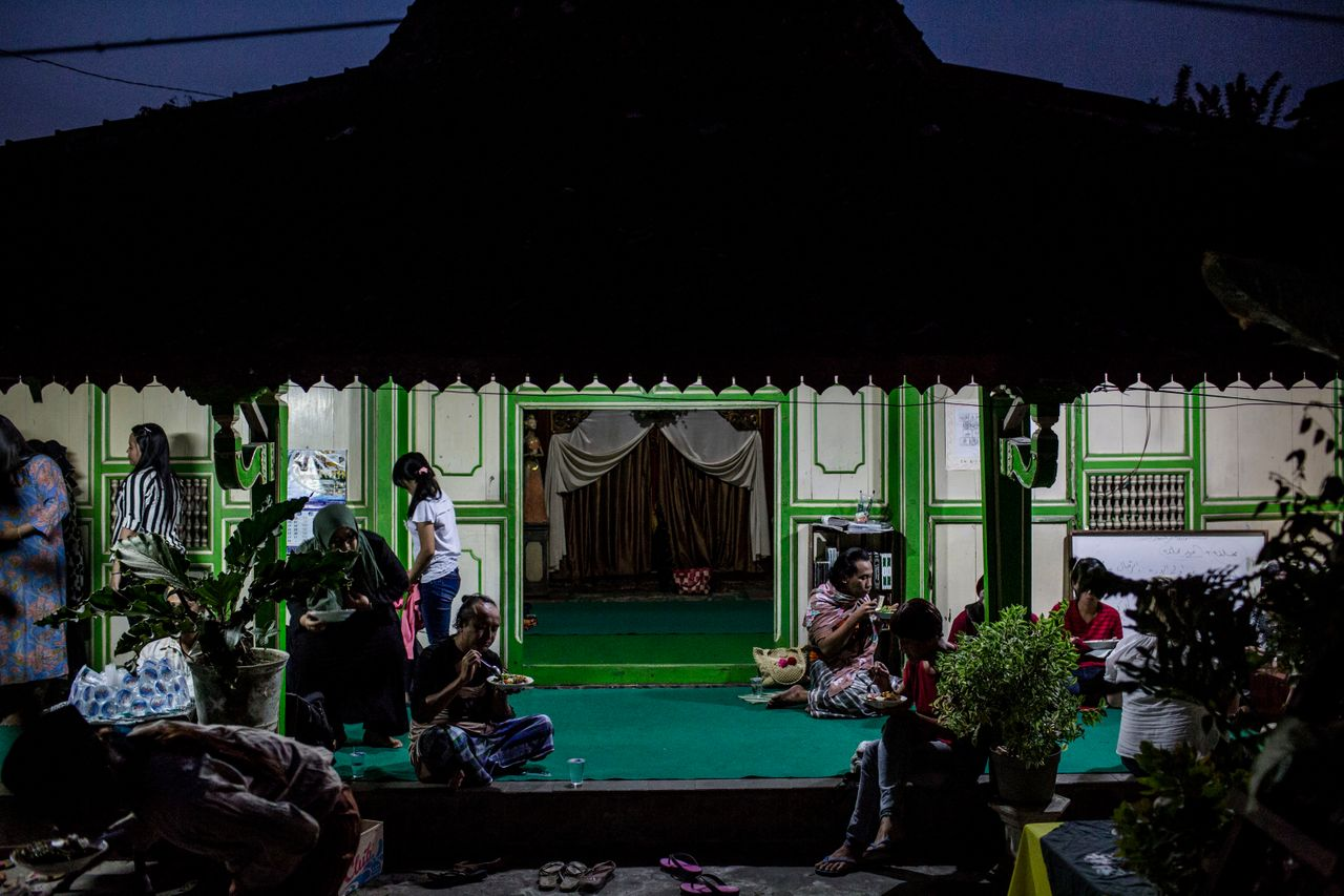 YOGYAKARTA, INDONESIA - JULY 12: Members of a Pesantren boarding school, Al-Fatah, for transgender people known as 'waria' eat as break their fast during Ramadan on July 12, 2015 in Yogyakarta, Indonesia. During the holy month of Ramadan the 'waria' community gather to break the fast and pray together. 'Waria' is a term derived from the words 'wanita' (woman) and 'pria' (man). The Koran school Al-Fatah was set back last year's by Shinta Ratri at her house as a place for waria to pray, after their first founder Maryani died. The school operates every Sunday. Islam strictly segregates men from women when praying, leaving no-where for 'the third sex' waria to pray before now. (Photo by Ulet Ifansasti/Getty Images)