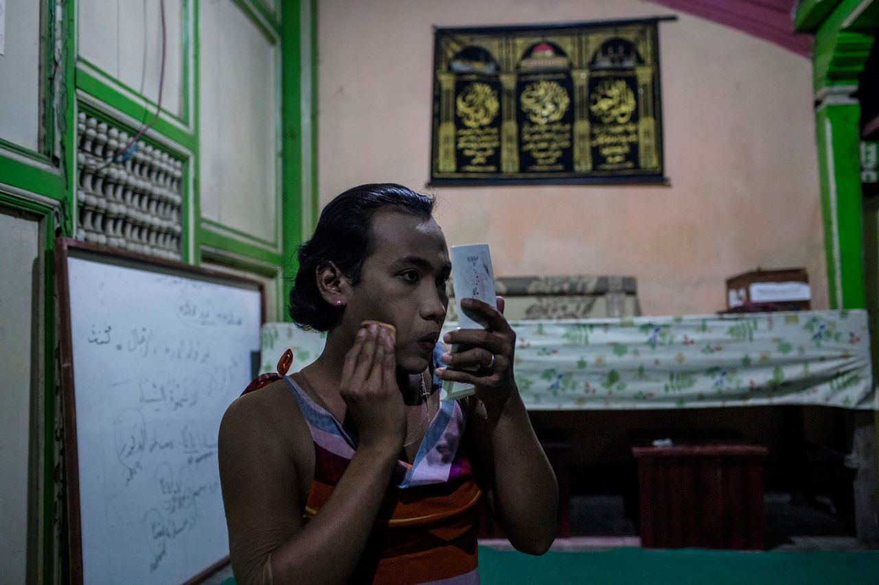 YOGYAKARTA, INDONESIA - JULY 12: Inez, a member of a Pesantren boarding school, Al-Fatah, for transgender people known as 'waria' applies make-up to her face during Ramadan on July 12, 2015 in Yogyakarta, Indonesia. During the holy month of Ramadan the 'waria' community gather to break the fast and pray together. 'Waria' is a term derived from the words 'wanita' (woman) and 'pria' (man). The Koran school Al-Fatah was set back last year's by Shinta Ratri at her house as a place for waria to pray, after their first founder Maryani died. The school operates every Sunday. Islam strictly segregates men from women when praying, leaving no-where for 'the third sex' waria to pray before now. (Photo by Ulet Ifansasti/Getty Images)