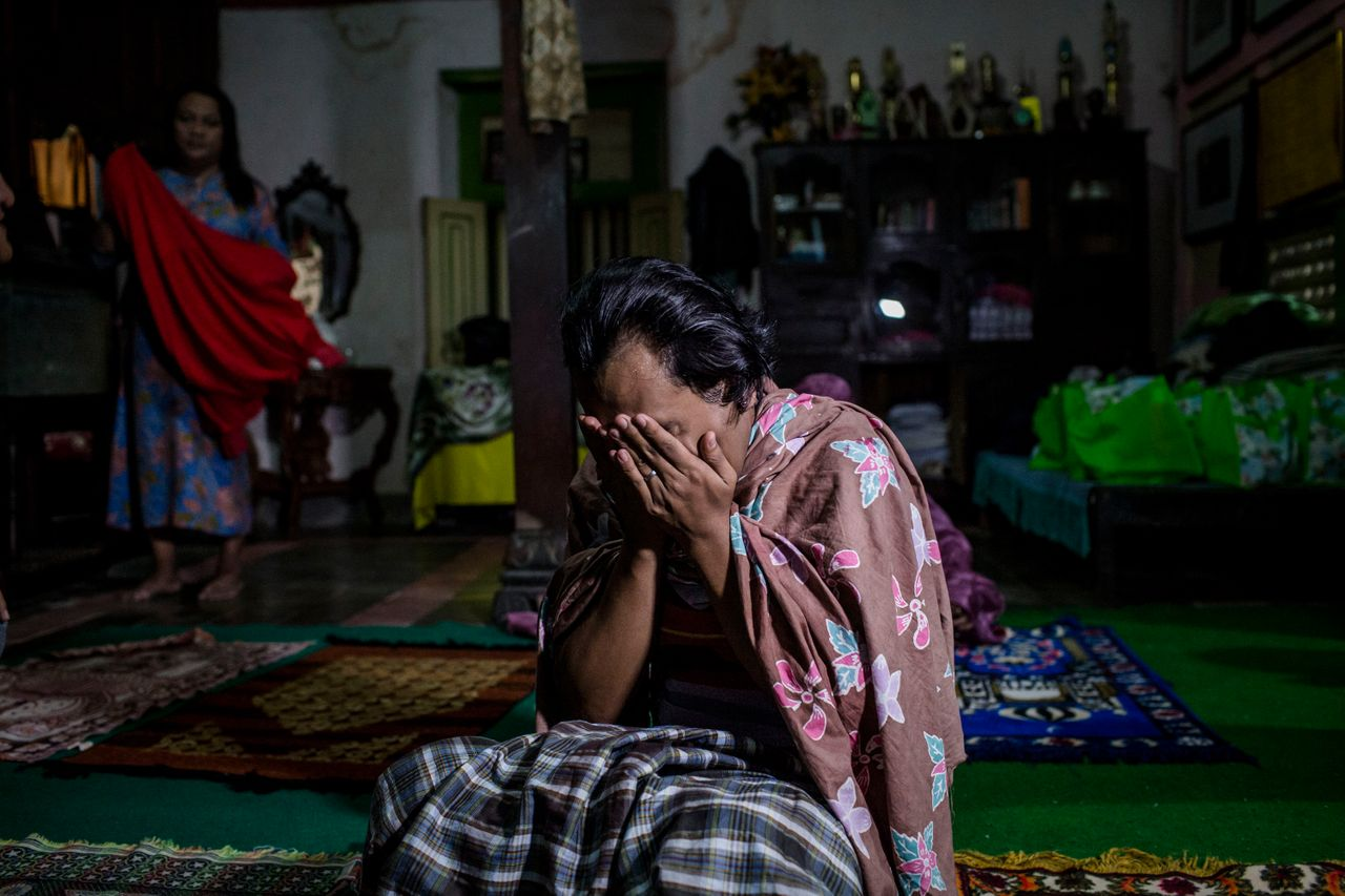 YOGYAKARTA, INDONESIA - JULY 12: Inez, a member of a Pesantren boarding school, Al-Fatah, for transgender people known as 'waria' pray during Ramadan on July 12, 2015 in Yogyakarta, Indonesia. During the holy month of Ramadan the 'waria' community gather to break the fast and pray together. 'Waria' is a term derived from the words 'wanita' (woman) and 'pria' (man). The Koran school Al-Fatah was set back last year's by Shinta Ratri at her house as a place for waria to pray, after their first founder Maryani died. The school operates every Sunday. Islam strictly segregates men from women when praying, leaving no-where for 'the third sex' waria to pray before now. (Photo by Ulet Ifansasti/Getty Images)