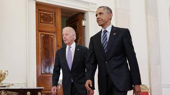 US President Barack Obama (R) and Vice President Joe Biden walk from the Green Room to speak on the nuclear deal with Iran on July 14, 2015 at the White House in Washington, DC. AFP PHOTO/MANDEL NGAN        (Photo credit should read MANDEL NGAN/AFP/Getty Images)