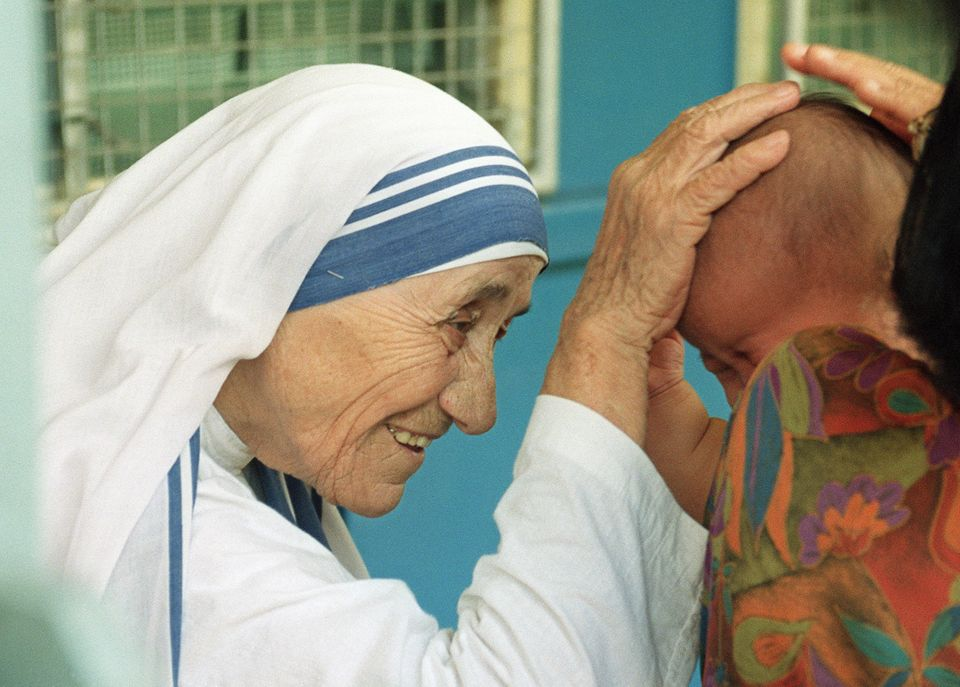 """""""Do ordinary things with extraordinary love.""""  Photo taken 20 October 1993 in Singapore of Mother Teresa blessing a child at"""