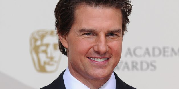 Tom Cruise Literally Hangs Off A Plane In Stunt Video For 'Mission Impossible: Rogue Nation'