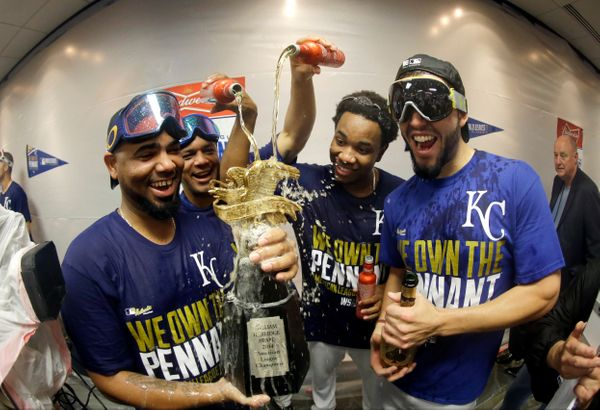 The Kansas City Royals players celebrate in the locker room after the Royals defeated the Baltimore Orioles 2-1 in Game 4 of