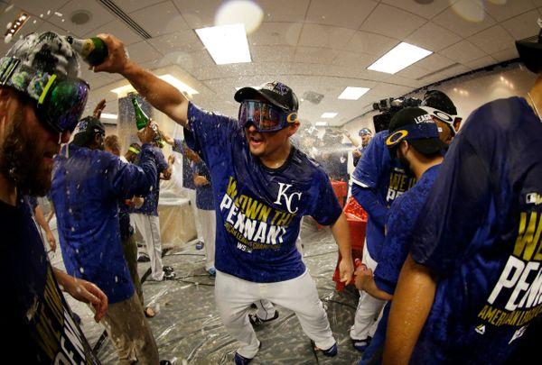 Kansas City Royals designated hitter Billy Butler celebrates in the locker room after the Royals defeated the Baltimore Oriol