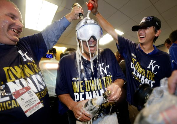 Kansas City Royals' Norichika Aoki, center, is doused in the locker room after the Royals defeated the Baltimore Orioles to w