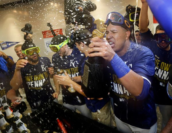 Kansas City Royals' Salvador Perez, right, celebrates celebrate in the locker room after the Royals defeated the Baltimore Or