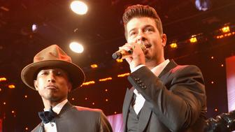 BEVERLY HILLS, CA - JANUARY 25:  Recording artists Pharrell Williams and Robin Thicke perform onstage during the 56th annual GRAMMY Awards  Pre-GRAMMY Gala and Salute to Industry Icons honoring Lucian Grainge at The Beverly Hilton on January 25, 2014 in Beverly Hills, California.  (Photo by Larry Busacca/Getty Images for NARAS)