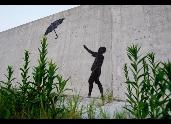 NEW ORLEANS - AUGUST 29:  Grafitti by the illusive artist Banksy adorns the levee wall in the Lower Ninth Ward on August 29,