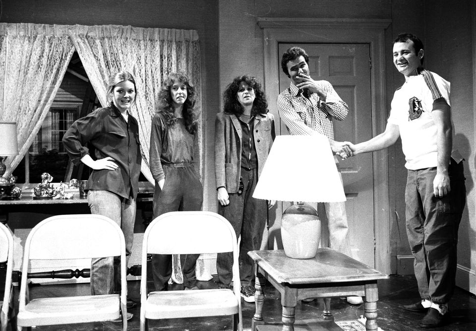 "Actor Burt Reynolds is shown on the set with cast members of NBC's ""Saturday Night Live,"" in New York, April 12, 1980.  From"