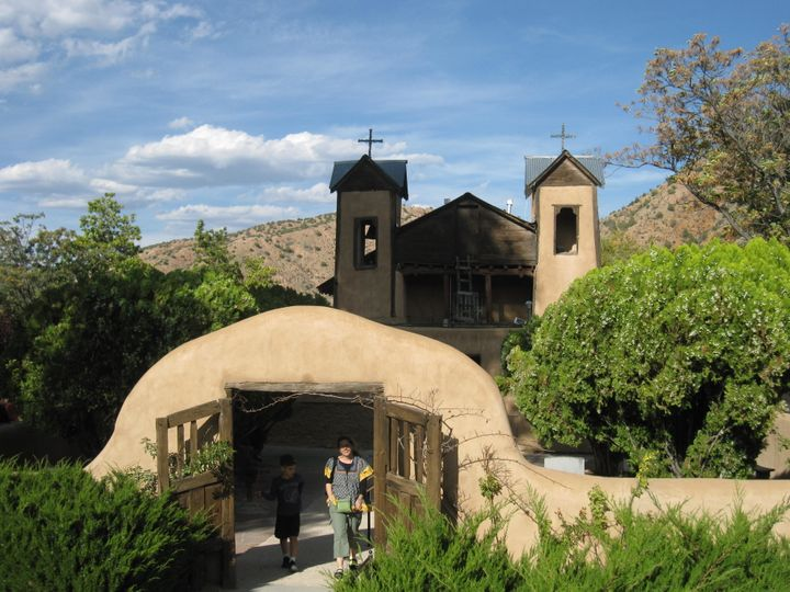 This October 2012 photo shows the Santuario de Chimayo, a picture-perfect adobe church with wooden gates. This 200-year-old N