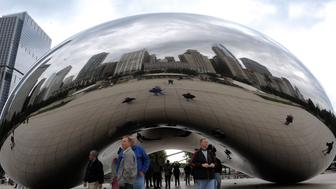 Chicago's skyline is reflected in the 'Cloud Gate' sculpture at Millennium Park in Chicago, October 01, 2009. US President Barack Obama heads to Copenhagen to join his wife Michelle in lobbying for Chicago's bid to host the Olympics in 2016. The International Olympic Committee is expected to deliver its choice between Chicago, Rio de Janeiro, Tokyo and Madrid on October 02, 2009. AFP PHOTO/Emmanuel Dunand (Photo credit should read EMMANUEL DUNAND/AFP/Getty Images)