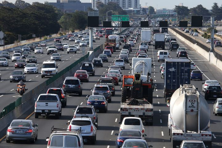 BERKELEY, CA - JULY 01: Traffic makes its way along Interstate 80 on July 1, 2015 in San Francisco, California. AAA is projecting that nearly 42 million Americans will travel 50 miles or more over the Fourth of July weekend, the largest number since 2007. (Photo by Justin Sullivan/Getty Images)