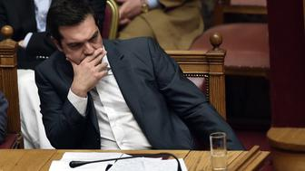 Greek Prime Minister Alexis Tsipras attends a parliamentary session in Athens on July 15, 2015. AFP PHOTO / ARIS MESSINIS        (Photo credit should read ARIS MESSINIS/AFP/Getty Images)