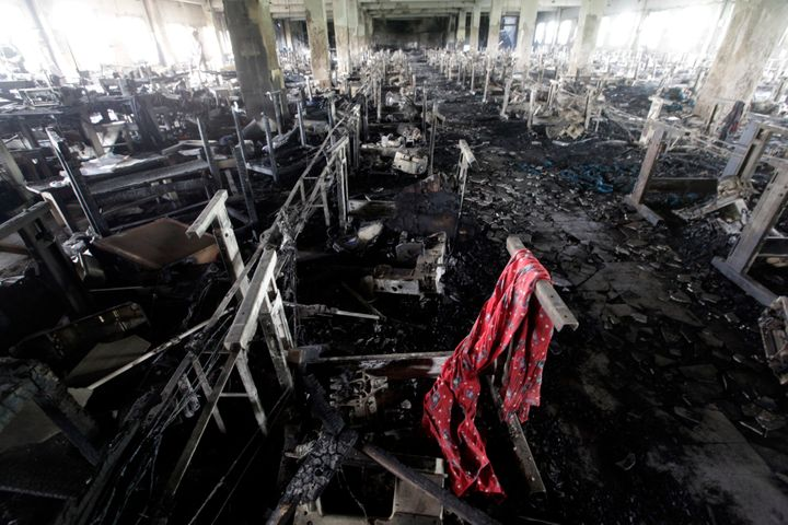 03 May 2013, Savar, Bangladesh, Bengal --- A scarf of a garment worker is seen in the burnt interior of garment factory Tazre