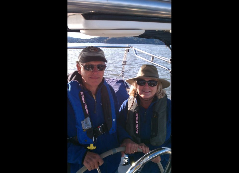 Ginger and Steve Penny sailing on their 38-foot Hunter, Windfall. The couple is downsizing from a 2,500-square-foot home to a