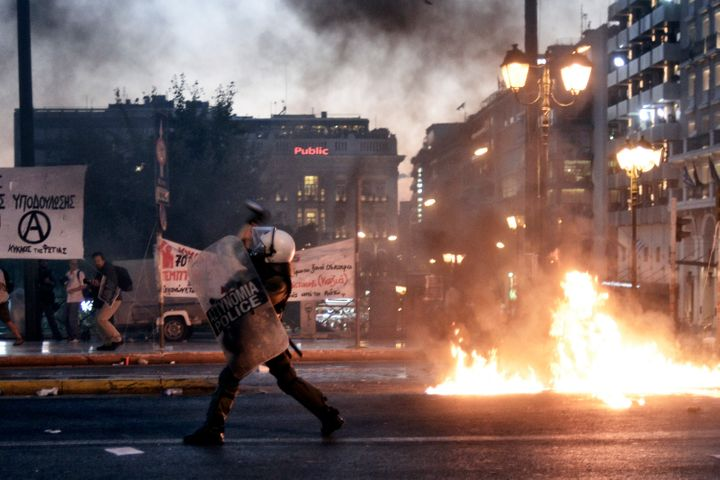 ATHENS, GREECE - JULY 15: Riot police use teargas in front of the Greek Parliament on July 15, 2015 in Athens, Greece. Anti-a