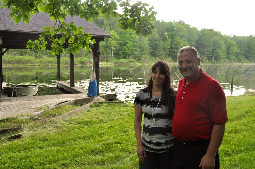 David Salha and his wife at their property in Lupton, Michigan.