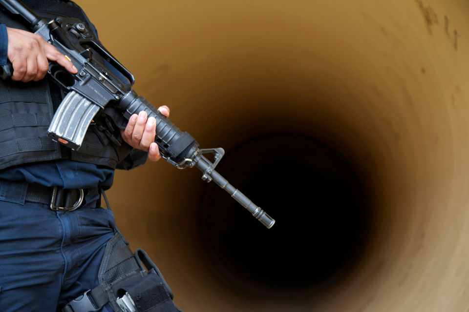 A federal police inspects a drainage pipe outside the Altiplano maximum security prison in Almoloya, west of Mexico City, Sun