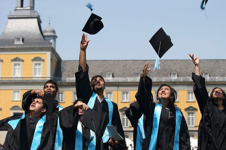 BONN, GERMANY - JULY 04:  Students throw up their graduate caps during the 11th celebrations of the Rheinische Friedrich-Wilh