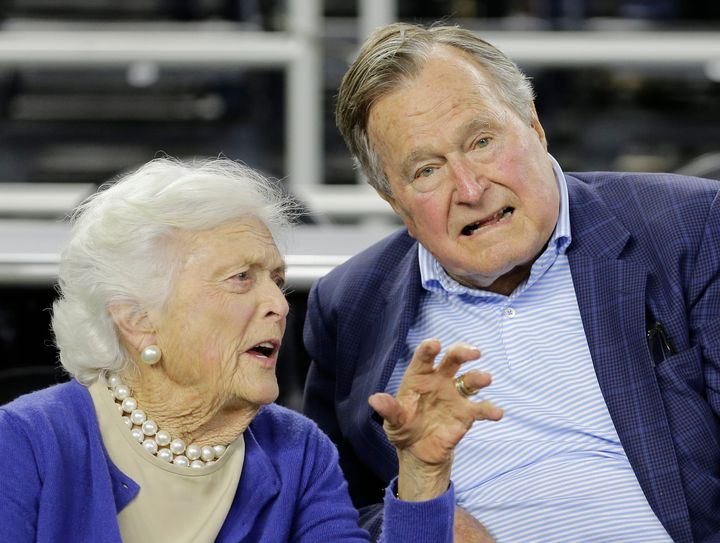 FILE- In this March 29, 2015, photo, former President George H.W. Bush and his wife Barbara Bush speak before the first half