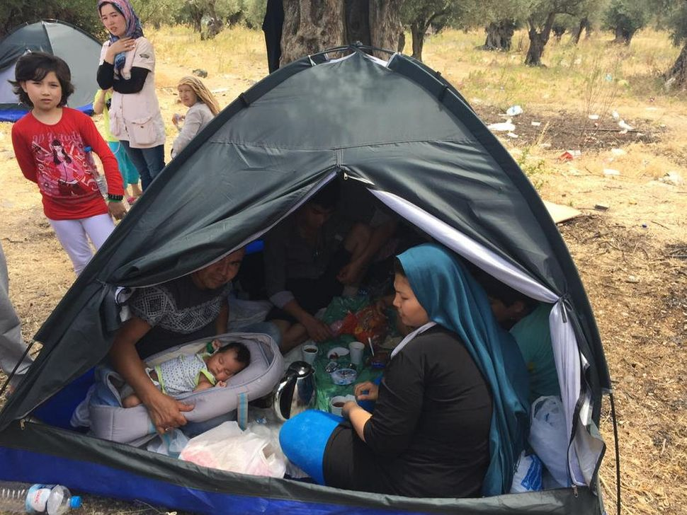 A migrant family rests at Kara Tepe camp in Lesbos, Greece.