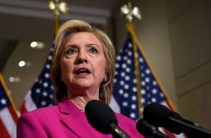 Democratic presidential candidate Hillary Rodham Clinton speaks to reporters on Capitol Hill in Washington, Tuesday, July 14,