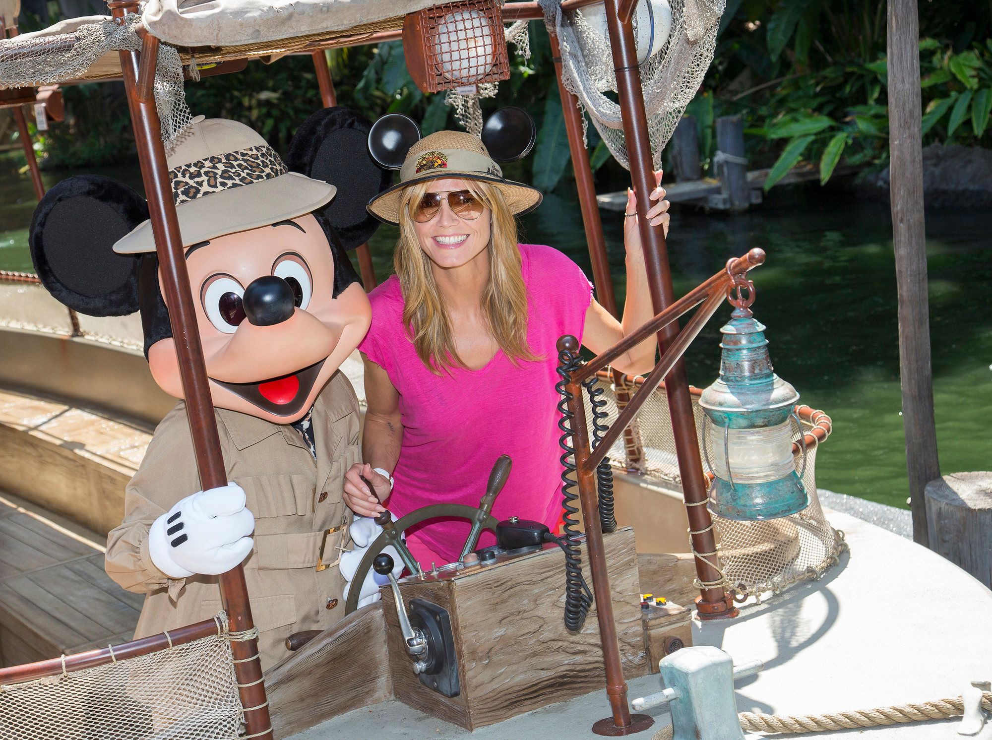 ANAHEIM, CA - MAY 28:  In this handout photo provided by Disney Parks, Heidi Klum joins Mickey Mouse aboard the world-famous Jungle Cruise attraction May 28, 2014 at Disneyland in Anaheim, California.  (Photo by Paul Hiffmeyer/Disney Parks via Getty Images)