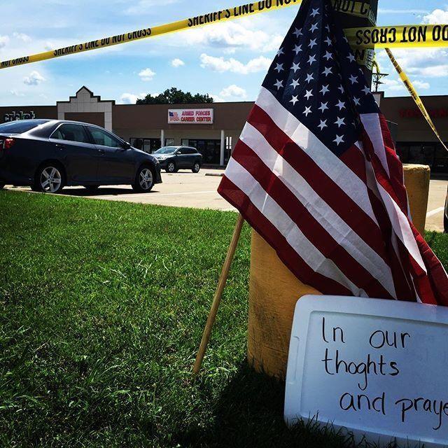 A memorial is set up at the Armed Forces recruiting center on Lee Highway in Chattanooga, Tennessee on July 16, 2015.