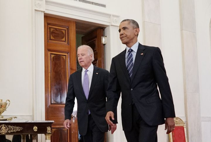 US President Barack Obama (R) and Vice President Joe Biden walk from the Green Room to speak on the nuclear deal with Iran on
