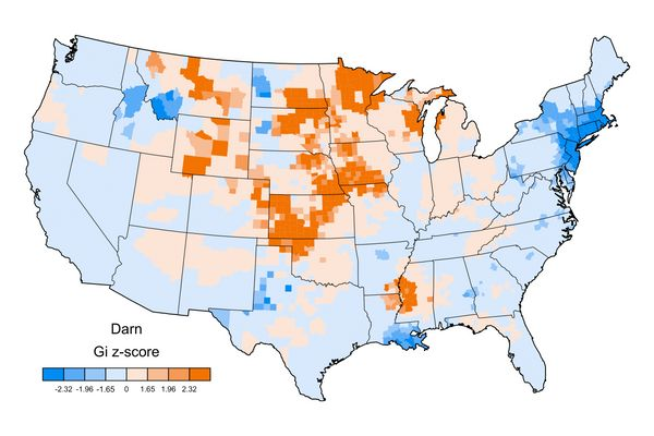 A positive z-score (orange clusters) represents U.S. counties where the word is relatively common, while a negative z-score (