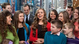 """NEW YORK, NY - MARCH 11:  The Duggar family visits """"Extra"""" at their New York studios at H&M in Times Square on March 11, 2014 in New York City.  (Photo by D Dipasupil/Getty Images for Extra)"""