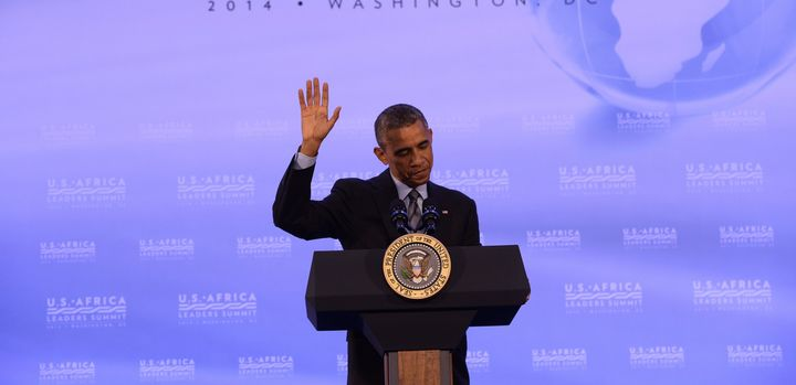 US President Barack Obama waves as he finishes a press conference at the end of the US-Africa Leaders Summit in Washington, D