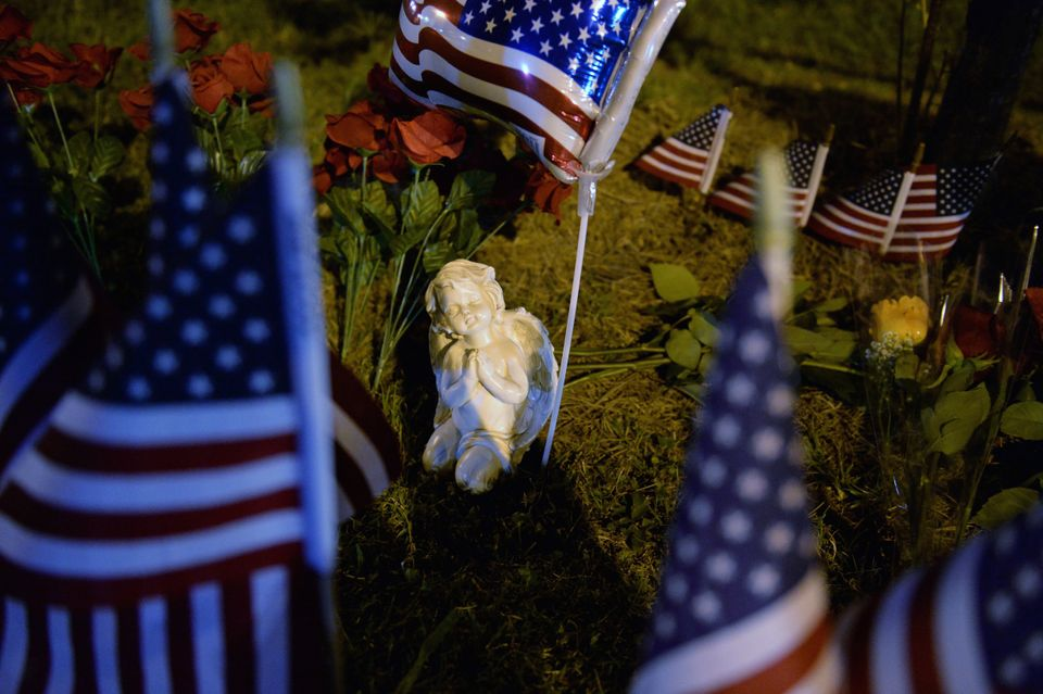 CHATTANOOGA, TN - JULY 16:  An angel statue sits in a makeshift memorial near the scene of a shooting at a Armed Forces Caree