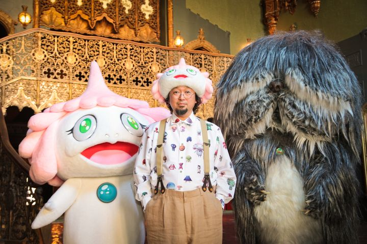 Director Takashi Murakami poses with characters from JELLYFISH EYES