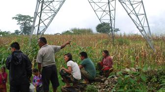 <p>Nepalese villagers, in the shadow of a controversial high-voltage transmission line financed by the World Bank</p>