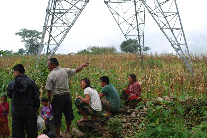 Nepalese villagers, in the shadow of a controversial high-voltage transmission line financed by the World Bank