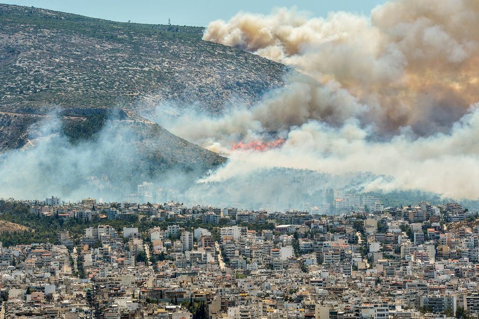 Smoke billows over Athens, Greece, on July 17, 2015.