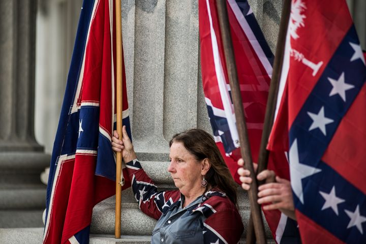 COLUMBIA, SC - JULY 6:  Confederate flag supporters gather at the state house July 6, 2015 in Columbia, South Carolina. The s