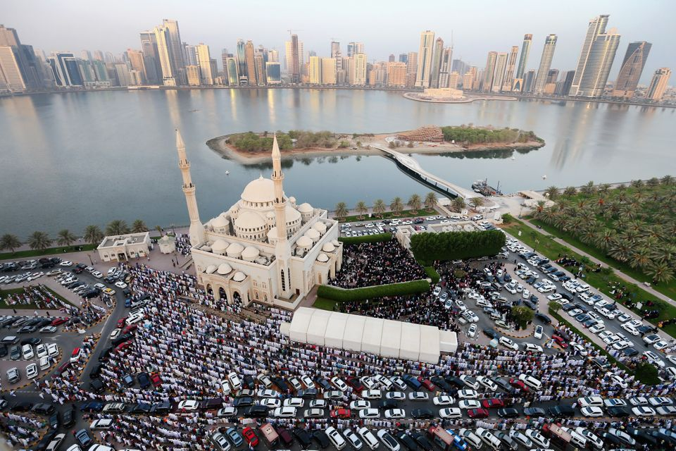 SHARJAH, UNITED ARAB EMIRATES - JULY 17:  Muslims offer Eid al-Fitr prayers outside Al Noor Mosque on July 17, 2015 in Sharja